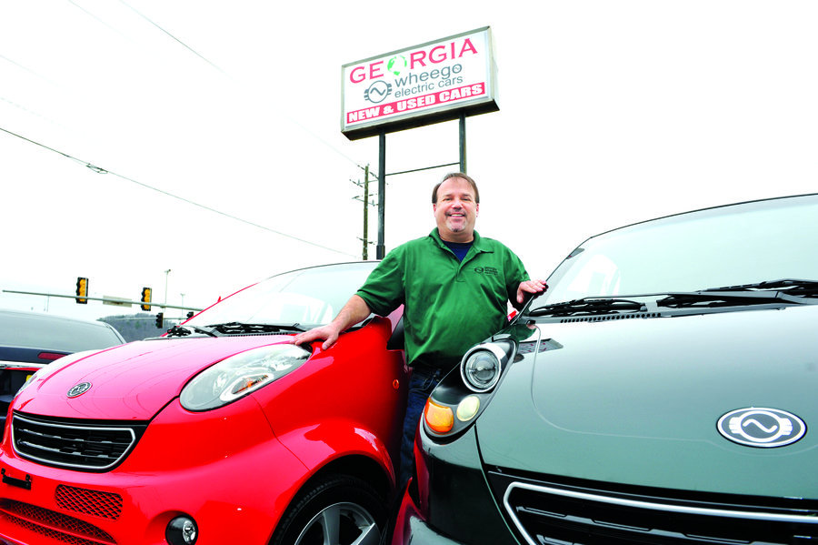 Georgia Wheego owner Keith Cristal of Marietta stands in between the Wheego Whip (left), and the Wheego LiFe (right). Photo by Sam Bennett. Read more: The Marietta Daily Journal - Cobb s Electric Connection